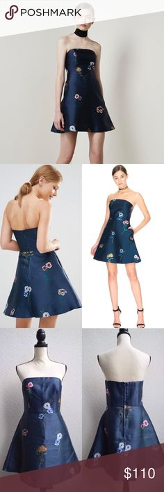 Keepsake After Glow Strapless Dress Floral Garden $175 Keepsake the Label After Glow Dress Strapless Floral Garden Print Blue  Size: Medium  Color: dark blue that looks dark gray in some light.   Sold out! Australian blogger fave by Keepsake the Label  After Glow Dress   CONTENT & CARE  Polyester  Dry Flat  Back zipper closure  Fit & flare with slightly boned bodice,  Flared/ flouncy skirt KEEPSAKE the Label Dresses Mini