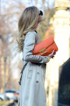 elegance & class in a trench, dark shades & a fabulous melon-orange clutch w/gold hardware