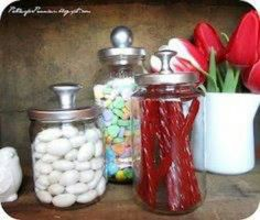 Leftover spaghetti sauce, pickle, condiment jars. Clean thoroughly, remove all stickers, spray paint lid if necessary, & glue inexpensive knob on top to create adorable canisters! Easy peasy!!