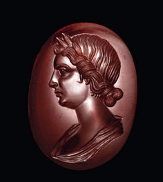 Ancient Roman garnet intaglio of Livia, crowned with a laurel wreath, dating to the early century CE. The intaglio was sold on Christie's. Roman Artifacts, Ancient Artifacts, Medieval Jewelry, Ancient Jewelry, Victorian Jewelry, Ancient Rome, Ancient History, Roman Hairstyles, Art Romain