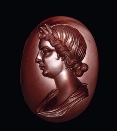 A LARGE ROMAN GARNET RINGSTONE PORTRAIT OF LIVIA CIRCA EARLY 1ST CENTURY A.D.