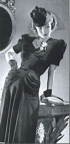 I love this elegant 1940s dress with loads of draping and ruching.
