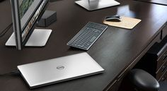 "Dell Precision. Silver and Lightweight. with - Dell UltraSharp 32"" Ultra HD Monitor with PremierColor - Dell Wireless Keyboard and Mouse Combo"