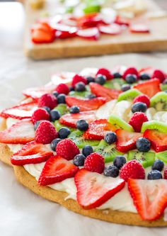 This fruit pizza with cream cheese frosting is so easy to make, gorgeous and super yummy. Fresh fruit on a giant frosted cookie. YUM!