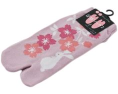 Our fun stretch ankle Tabi Socks are made to look like the traditional Japanese socks, featuring a 'gap' or 'separation' between the big toe and other toes. The traditional Japanese pattern of Cherry Blossoms & a white rabbit against a pink background.