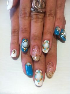 Detailed nail art... Maybe for the beach.