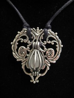 urban artifact necklace - caged frosted white beach glass, sterling silver filigree jewelry component