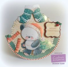 Crafters Companion Party Paws Christmas CD2 Rocker Card D10. Collall 3D Gel & Tacky Glue. Red colorcore card. Glitter glues, Bells & Pearly doodles in red & Green.Insert from disc