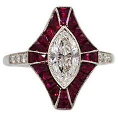 Sophia D Diamond And Ruby Ring    Art Deco Style  Center Marquise Cut Diamond weighs .82 carat  Clarity SI 1  Color I