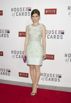 Kate Mara  This is such a stunning and elegant dress. It's form-fitting without being too tight. I love the embellished top, and how it's finished with a simple banded waist!