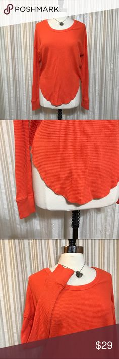 💜Free People orange thermal top Size XS. We The Free. Long sleeve oversized pullover shirt with rounded hem. Cotton, polyester. EUC (2.1.2)  💟Fast 1-2 day shipping 💟Reasonable offers accepted 💟Purchase 3 or more items & get a special bundle rate!  💟Smoke-free home Free People Tops