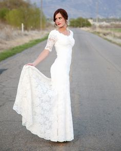 Oh so pretty lace wedding dress with 3/4 sleeves | http://www.weddingpartyapp.com/blog/2014/09/02/45-long-sleeved-wedding-dresses-for-fall-brides/