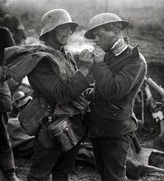 A German and a British soldier exchange presents on Christmas day during a truce, 1914