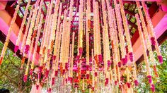 Wedding mandap decorated with Marigold strings with Rose petals, bell ends and Rose petals
