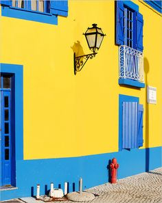 Traditional house painted in yellow and blue in Aveiro. Portugal