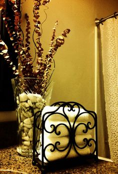 """A napkin holder makes a great hand towel holder.  The vase is filled with rocks that have """"blessings for our marriage"""" written on them from guests at my bridal shower back in 2006."""