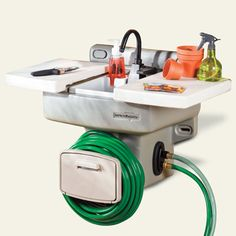 This wall-mount vessel hooks up to a hose to create a no-plumb, cold-water washing station for outdoor kitchens. Add a second hose, and you can divert wastewater to garden beds. | thisoldhouse.com