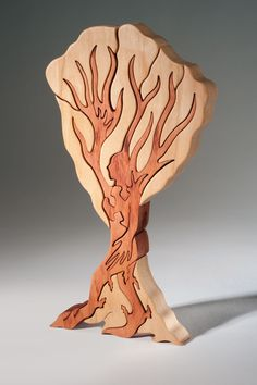 This dryad puzzle was refined over many sketches by Judy Peterson. Learn more in Scroll Saw Woodworking & Crafts Fall 2015 (Issue 60) at http://scrollsawer.com/2015/07/15/scroll-saw-woodworking-crafts-fall-2015-issue-60-2/.