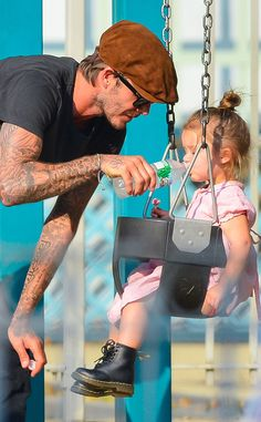 David Beckham and daughter Harper. Look af those little dr. Martens so so cute.