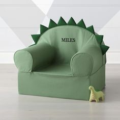 Inspired by everyone's favorite giant reptiles, our green dinosaur kids chair has decorative dino details on top. The soft, frameless design makes it great for kicking back after a long day of prehistoric play. Dinosaur Kids Room, Boys Dinosaur Bedroom, Dinosaur Room Decor, Dinosaur Nursery, Dinosaur Bedding, Dinosaur Dinosaur, Big Boy Bedrooms, Baby Boy Rooms, Kids Bedroom
