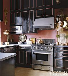 In the Manhattan penthouse apartment she shares with her husband, restaurateur Georgette Farkas infused her kitchen with Parisian flair. The walls, which are painted in Benjamin Moore's Pink Mix, offset black-painted cabinetry. The range is by Blue Star, the hood is by Best, and the microwave is by GE Monogram.