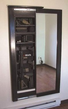 Hidden gun cabinet behind a mirror. We won't have that many, but for the ones we do. This is an idea! Hate the look of a gun cabinet Hidden Gun Cabinets, Hidden Cabinet, Bar Cabinets, Medicine Cabinets, Mirror Cabinets, Cabinet Doors, Hidden Gun Storage, Secret Storage, Weapon Storage