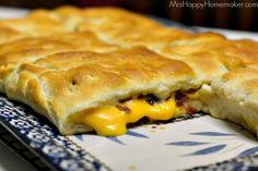 THIS IS AMAZING! A must make item! Serve it with tomato soup instead of regular grilled cheese. Grilled Cheese Bacon Crescent Squares - Mrs Happy Homemaker