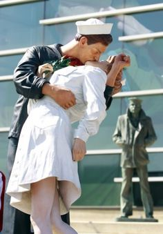 Statue of famous WWII Sailor and Nurse kissing in Times Square on V-J day stands in front of the Lone Sailor statue at the Sullivan Brothers Iowa Veterans Museum is Waterloo,IA.  http://www.groutmuseumdistrict.org