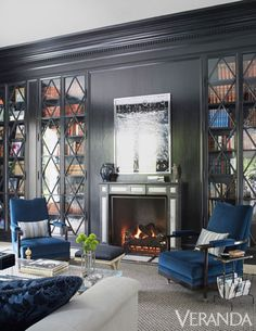 Antiqued glass cabinets in this library add a modern touch.DESIGN BY DANIEL CUEVASTour the entire home.    - Veranda.com