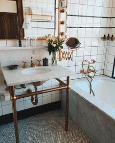 Eclectic bathroom with bronze features