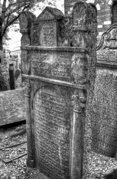 The Prague Jewish Cemetery, where 12,000 gravestones are packed in closely together up to 12 tombs deep dating back to the 15th century.