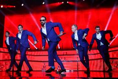 Description of . The Backstreet Boys, from left to right, Kevin Richardson, Howie Dorough, A.J. McLean, Brian Littrell and Nick Carter, preform at the Shoreline Amphitheatre in Mountain View, Calif. on Sunday, May 25, 2014.  (Nhat V. Meyer/Bay Area News Group)