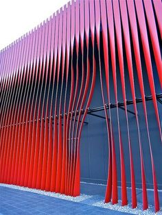 It would be SOO fun to make it so that whenever you walked near a blind, it mechanically got forced to open, no electricity required! Nebuta House, Aomori, Japan, by molo design  when someone walks by, make a thing pull several of the panels closer, creating an organic door space red accent