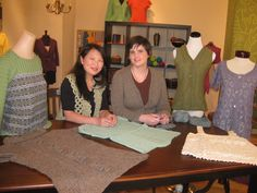 Eunny Jang & Kristen TenDyke on the set of Knitting Daily TV, with sweaters from Kristen's book, Finish-Free Knits.