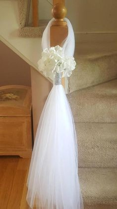 Tulle hangers wrapped with rhinestones with a silk flower at.- Tulle hangers wrapped with rhinestones with a silk flower attached. Each one han… Tulle hangers wrapped with rhinestones with a silk flower attached. Each one hangs long. Wedding Pews, Wedding Aisle Decorations, Wedding Chairs, Wedding Suits, Trendy Wedding, Wedding Centerpieces, Wedding Events, Wedding Flowers, Dream Wedding