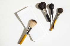 We know you've probably been using hand soap and oil to clean your makeup brushes, but you can also use baking soda. Just dip your brush in a bath of warm water and a few teaspoons of sodium bicarbonate to dissolve product buildup. This is also a good trick for old toothbrushes, hairbrushes, and combs.