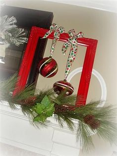 Framed Ornaments: Spray paint an old frame and use festive ribbon to hang a couple ornaments for display.