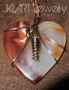 Another polished agate pendant -- heart