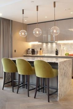 The curved backs of the upholstered bar stools add a soft touch to the modern kitchen. Kitchen Stools Uk, Bar Stools Uk, Green Bar Stools, Green Kitchen Decor, Bar Stools With Backs, Modern Bar Stools, Home Decor Kitchen, Kitchen Design, Kitchen Island With Chairs