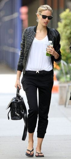 Gorgeous black leather jacket under white loose tee shirt and black pants and black leather cute hand bag and black pumps the best street st...