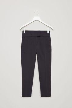 COS image 2 of Slim-fit pressfold trousers in Dark Navy