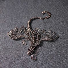 Copper brooch Dragon with garnet eyes and heart by AnnTitovaDesign