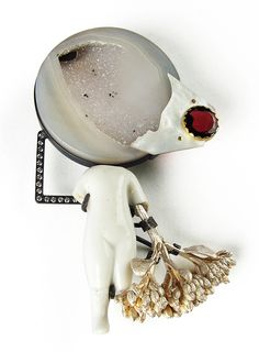 The man carrying a bountiful harvest, walks into the light of the moon... abstract imagery made into the form of a brooch