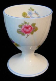 This is an eggcup or egg cup made by Shelley China, England in the Rose Pansy and Forget Me Not pattern 13424 and the Dainty shape with blue trim made 1940-1966   85.00