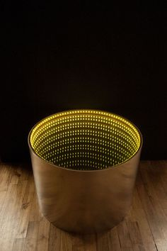 """The """"Infinitum"""" infinity mirror is an Arduino-powered light table that turns on when items are placed on it, but turns off when they are removed. Designed by Louise-Anne van 't Riet as part of her Making Studio course, she wanted …"""