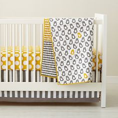 Baby Crib Bedding: Baby Grey & Yellow Patterned Crib Bedding in Nursery | The Land of Nod