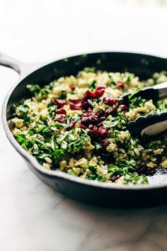 Garlic Kale and Brown Rice Salad with a zippy lemon herb dressing! This side recipe is so simple and it compliments almost any main dish! Vegetarian, vegan. | pinchofyum.com