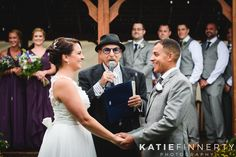 Rainy day wedding! Bride and groom say their I do's in the rain at Sodus Point, photographed by Rochester, NY wedding photographer Katie Finnerty Photography | http://www.katiefinnertyphotography.com/blog/2015.9.25.sodus-point-wedding-becca-jay