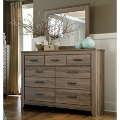 Create a more natural feel to your bedroom with this lovely pairing of a dresser and mirror.