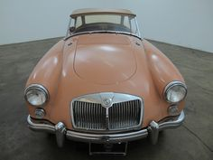 1961 MGA 1600, salmon with red interior, comes with side curtains, soft top and 4 speed manual transmission. It is a presentable car with very minor blemishes that is mechanically sound. For $15,750  If you have any additional questions Please call 310-975-0272